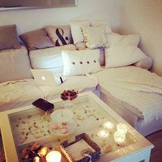 So cosy room! Candles, white sofa, cushions, love that!