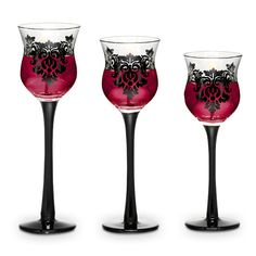 """FORBIDDEN TRIO 4 out of 5 Read all 3 reviews  Write a review Item #:  P91307   A romantic damask motif and midnight black stems add drama to our curvy glass candle holders. For use with a votive or tealight, sold separately. One of each height: 6½""""h, 7""""h, 7½""""h.  $35.00/set of 3"""