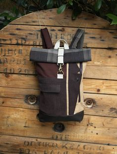 Brown upcycled rolltop rucksack using the front pocket of of a corduroy men's suit & with an extra opening for easy access to your stuff, by 'eating the goober'