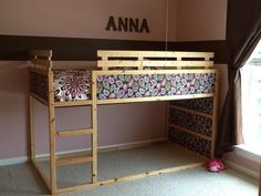 Ikea Kura bed with fabric spray glued to the panels. We added extra wooden guard rails because we used a standard size twin mattress. I plan on putting a brown and white polka dot curtain around the bottom of the bed so the girls can use the space as a play-fort