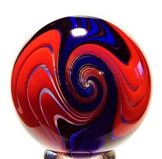 I love the clarity of the distinction between the colors and the sharpness of the design. My Glass, Glass Ball, Marble Art, Glass Marbles, Glass Paperweights, Glass Collection, Crystal Ball, Glass Ornaments, Red And Blue