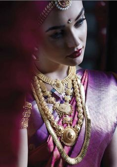 Purple silk kanchipuram sari with pink blouse.Braid with fresh jasmine flowers. Amy Jackson for Tanishq. Indian Bridal Fashion, Indian Wedding Jewelry, Bridal Jewelry, Bridal Makeup Looks, Bridal Looks, Bridal Style, South Indian Bride, Kerala Bride, Hindu Bride