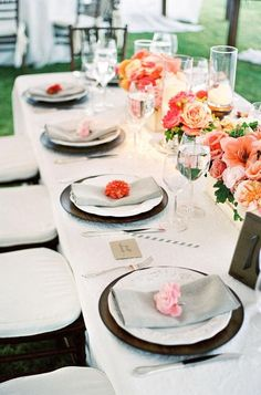 wedding tables & centerpieces - I like how they have a little flower on the napkins. would add nice color since the table clothes and napkins will be mostly the same color - white.