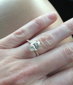 My engagement ring! Oval diamond, yellow gold micro pave band. So delicate.