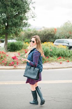 navy vest and dress outfit