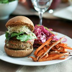 Veggie burger on home made whole wheat buns, served with a side of crispy oven baked sweet potato fries and sour coleslaw.