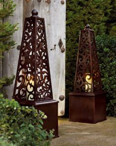 Love, love these obelisks for lighting in the garden (pinned this from the best garden board I've seen)