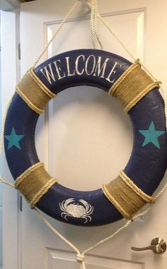 beach.quenalbertini: 'Welcome' Life Preserver Ring Door Decor | by Castaways Hall on Etsy