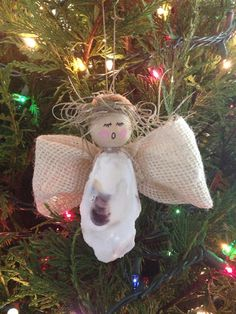 Oyster shell angel with burlap wings and Spanish moss hair.
