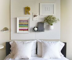 A pegboard headboard would also be an ingenious and practical idea. You can turn this into a weekend DIY project and you then you can use the headboard to also hang some decorations, maybe even a planter for some freshness and a shelf for the alarm clock.
