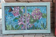 A fine Art Stained Glass Mosaic repuropsed window. After cutting each piech by hand i fashion the glass into a fine art painting, glue each piece onto the window and grout. It is a one of a kind stained glass fine art piece.