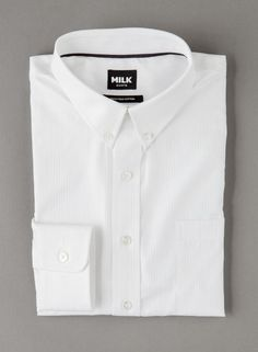 Crafted from luxurious two-fold striped twill, this shirt features a classic button down collar, single buttoned cuffs, and a single chest pocket to store your essentials. This wardrobe staple is perfectly suited for office dressing. Left open at the collar and worn under fine knitwear this style will add a sophisticated touch to your work wardrobe. Details: Soft semi-spread collar; Single buttoned cuffs; Contrasting lilac lining inside collar, yoke, placket and cuffs; 100% Two-fold cotton…