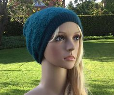 Hand knitted double beanie knitted with QIVIUT and Suri