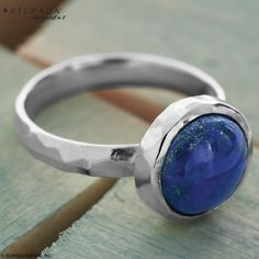 True Blue Ring. Genuine Lapis and Sterling Silver team up to make the True Blue Ring a classic gem. Pair it with other cool tones, such as a teal tank and skinny white jeans.