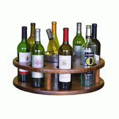 2-Day Designs Wine Around With Bucket 577B - 2-Day Designs Brown Wine Around With Bucket 577BThis wine carousel features 8 bottle storage and includes chiller bucket.SKU: 577BManufacturer: 2-Day DesignsMaterial: WoodFinish: BrownType: Wine RackShape: RoundStyle: ContemporaryDimensions: 20 W x 20 D x 6 H Inches