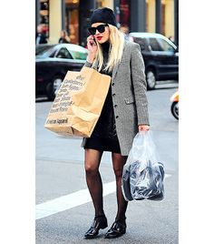 Rita Ora shopping wearing a great coat and a chic beanie.
