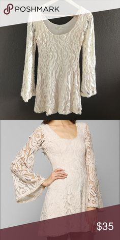 """Staring at Stars UO Lace Bell Sleeve Mini Dress Super cute bell sleeve dress from Staring at Stars and Urban Outfitters. Pretty short on me, and I'm 5'2"""" so I would say it probably wouldn't work for anyone that's tall. In great condition! 