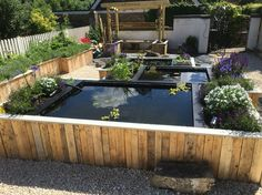 Raised pallet flower bed garden fun pinterest flower for Flower beds out of pallets