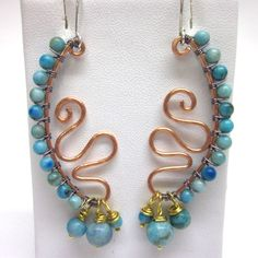 Hand crafted copper wire hammered  beaded earrings with turquoise jasper wire wrapped beads and charms