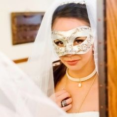 A romantic masquerade wedding in Fallbrook, CA with a Purple, Silver and Black color scheme.
