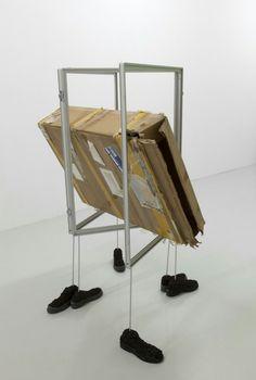 Kristina Bengtsson, New Outline, 2016, Soil, shoes, aluminium, cardboard box