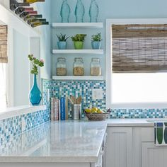 Beach Style Kitchen by Dean J. Birinyi Photography