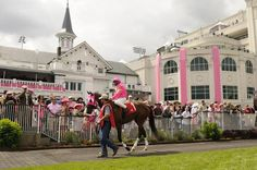 Kentucky Oaks - May 2, 2014 - Pink Out!  -This one is for the ladies! In addition to it being the fillies day to shine, it is also an opportunity to focus on the prevention and detection of breast and ovarian cancer.   There will be a parade of strong women who have survived breast or ovarian cancer. Photo by Churchill Downs #kentuckyoaks #churchilldowns