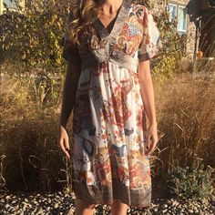 Paisley dress Gorgeous in like new condition dress! Very gently used. Comes with full slip. Side zipper works good. Size small. Beautiful colors! Thank you for looking! Dresses Midi