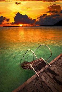 Soaking my feet in warm ocean at sunset.