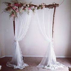 Vintage wedding arbour. With lace curyains and fresh flowers. Ceremony decoration and styling. For all your Wedding hire needs Chairs, arches, aisle decorations. Specialising in Garden and Beach weddings- Victoria wide