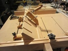 "Table Saw Sled Bevel Guide by Lumberpunk -- Homemade table saw sled bevel guide constructed from MDF. Intended to facilitate the process of cutting of 45-degree bevels up to 24"" long. http://www.homemadetools.net/homemade-table-saw-sled-bevel-guide"