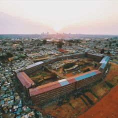 Another view of Madala Hostel in Alexandra Township. You can see Sandton in the distance. The buildings shape is so it allows more light to penetrate throughout the building🌇 Hostel, South Africa, Paris Skyline, Distance, City Photo, Buildings, Shape, Travel, Viajes
