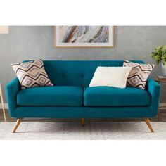 Defined by subtly button-tufted upholstery, splayed legs, and a clean-lined silhouette, this understated sofa adds a touch of midcentury modern style to your living room or parlor ensemble. Furniture, Sofa Upholstery, Modern Furniture, Sofa Design, Sofa, Home Decor, Sofa Set, Living Room Sofa Design, Tufted Sofa