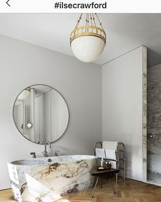 Pendant-lamp with a punched brass-rim and a handblown opaline-glass, hanging on braided wires, decorated with brass-balls Luxury Interior Design, Bathroom Interior Design, Sasha Baron, Bathroom Goals, Bathroom Inspo, Living Room Trends, Decoration Design, Round Mirrors, Interior Inspiration