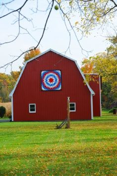 make cardboard barn shape and have students make paper quilt. Red white and blue barn quilt