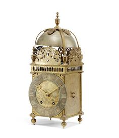 """A brass lantern clock with later movement Signed on the dial plate """"Thomas Knifton at the Crossed Keys in Lothbury"""", mid 17th century and later"""