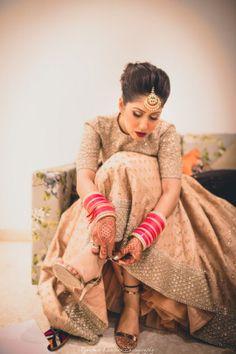 Bridal Details - Zorawar & Mallika wedding story | WedMeGood | Getting Ready Bridal Shot #wedmegood #indianbride #indianwedding #bridallehenga #gold #sequinned