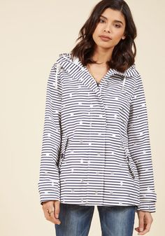 <p>You'll wish for cloudy weather once this white anorak from Joules joins your jackets. Decorated with navy stripes and metallic silver spots, this hooded coat and its breathable, cotton exterior, button-closed pockets, and tapered seams make it 100% waterproof and totally forecast-friendly!</p>