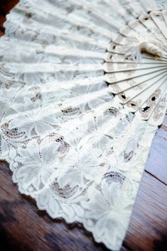 Find some white lace fans - it might be hot, and this would be a cool way to keep cool :)