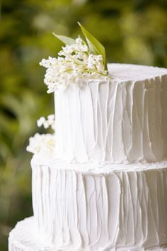 Wedding cake with lilies of the valley via Once Wed. Cake by Christine Dahl. Photo by Allyson Magda.