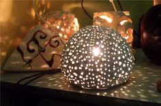 lamp urchin. The study of sea urchins was born a beautiful lamp in cooked earth, made entirely by hand.  www.laputea.com