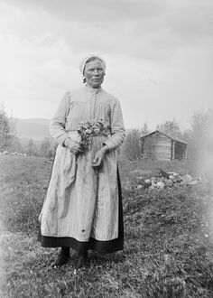 Almo, Dalarna, Sweden, 1930. Greta Persson at a hut. Wife of the yeoman farmer Ollas Per Persson in Almo, Dalecarlia. (Photo by Einar Erici)...