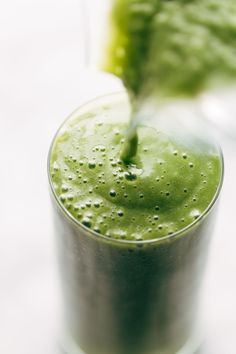 THE BEST GREEN SMOOTHIE! ♡ The best tasting, best textured green smoothie I've ever had. Five ingredients - peaches, mango, kale, almond milk, and ginger. Honey or cinnamon if you want. #cleaneating #greensmoothie #vegan #plantbased #dairyfree #smoothie #kale #healthyrecipes #breakfast #mealplanning | pinchofyum.com