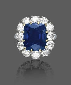 A FINE SAPPHIRE AND DIAMOND RING, BY HARRY WINSTON Set with a cushion-shaped sapphire, weighing approximately 7.92 carats, in a brilliant-cut diamond surround, 1958