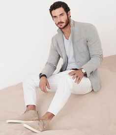Massimo Dutti March Lookbook - Piquè cotton blazer with a V-neck lite sweater, white coloured pants and suede ankle boots. #massimodutti #lookbook #men #march #2014