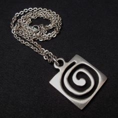 Rune Tennesmed (SE), mid-Century vintage pewter pendant with an organic spiral cut within a square. #Sweden | finlandjewelry.com