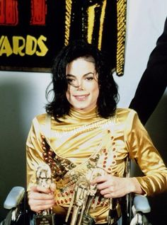 Michael in a wheelchair with his awards (Soul Train Music Awards 1993) - I love this man to death. He could've cancelled the performance because of his sprained ankle but he didn't ♡