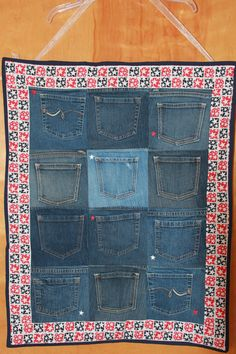 Wall hanging organizer made from denim pockets and fabric. Something similar might be cool for the classroom?