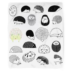 Ever wanted to cuddle up in a pile of hedgehogs? Here's your non-prickly, totally fluffy dream come true!  Express your love for these spiney yet loveable little mammals with this statement piece. This super adorable design by artist Julie Kuois too cute and cozy to resist. Our blankets are the softest throws around and they're the perfect accessory for snuggling in style!  Blanket Details: - Printed in USA!  - Poly Fleece Plush Material - Custom Printed on front - Taupe Color Brushed…