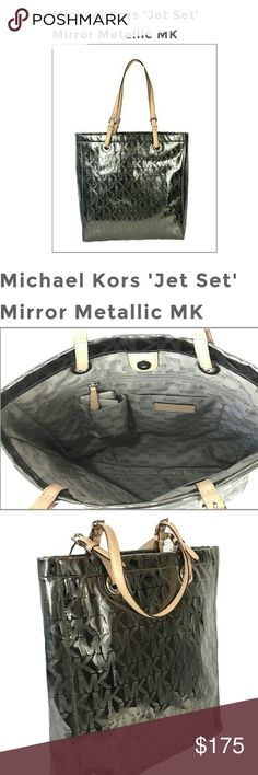 """Authentic! MICHAEL KORS 'JET SET' MIRROR METALLIC Authentic MICHAEL KORS 'JET SET' MIRROR METALLIC MK SIGNATURE TOTE, NICKEL all offers welcome!!!  Tote in coated signature embossed mirror metallic trimmed in leather. Custom colden hardware.  Leather belt shoulder straps w 9"""" drop Magnetic closure. Lined. zip and two open pockets 15""""H x 14""""W x 4""""D.  There are 2 barely noticeable marks this bags never been used might of happens when it was stored away. See pictures for details let me know if…"""